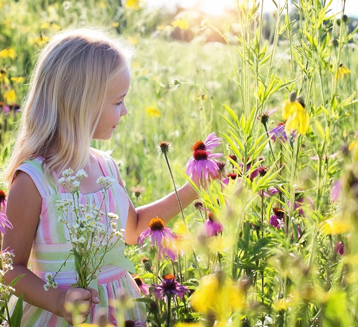 girl walking in a prairie garden